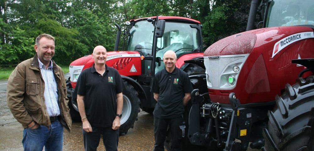 Venture Farm Machinery partners Jim Pearson and Nigel Gardiner with Derek Lispcombe.