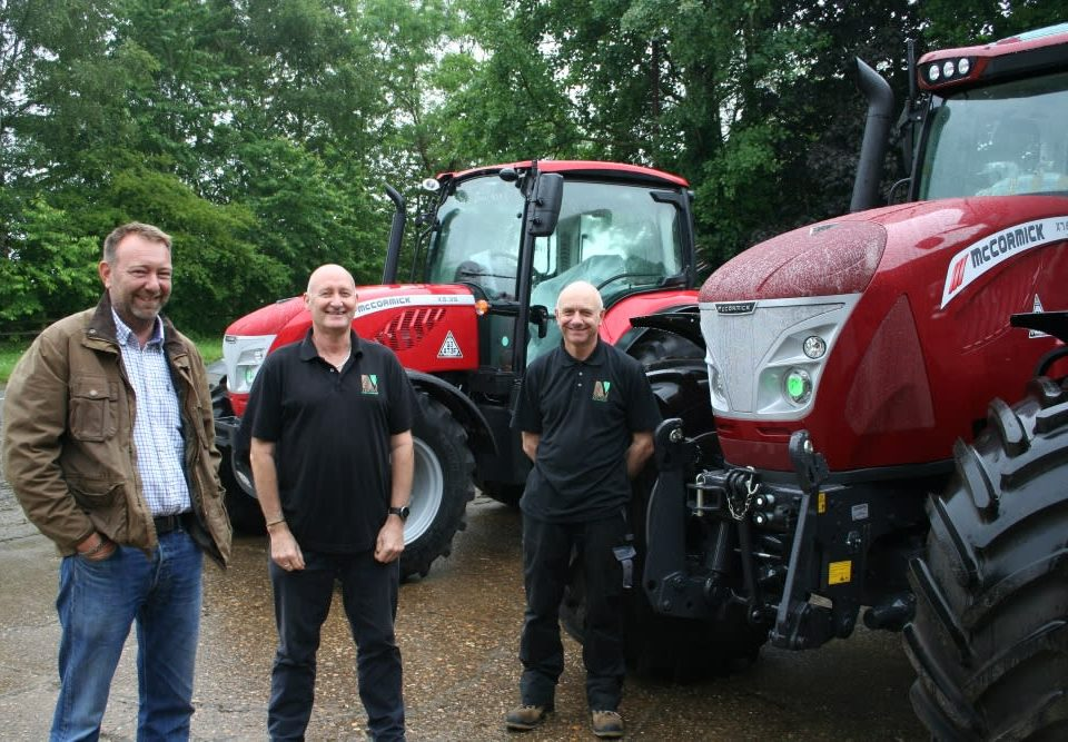 Venture Farm Machinery partners Jim Pearson and Nigel Gardiner with Derek Lispcombe.