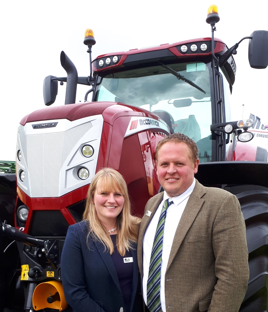 Show Liz and David Moore with a McCormick X8 VT-Drive tractor