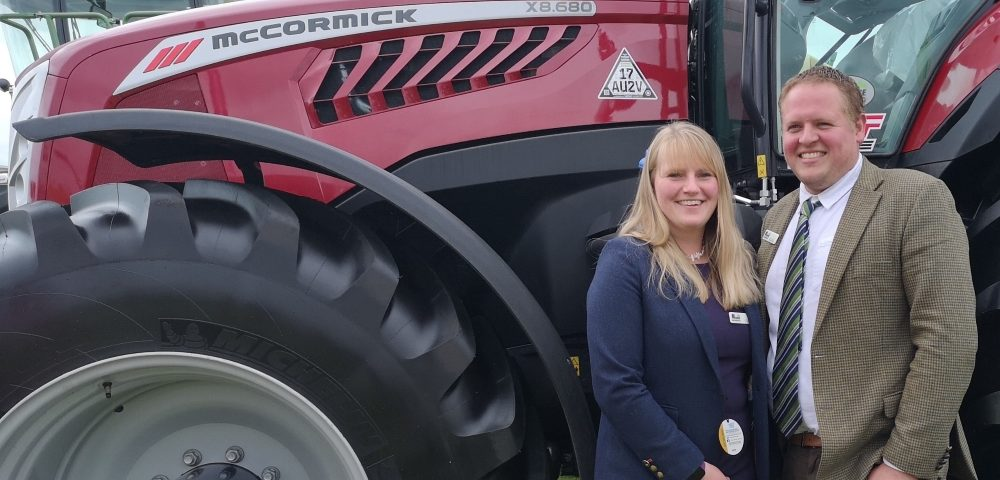Show Liz and David Moore with a McCormick tractor
